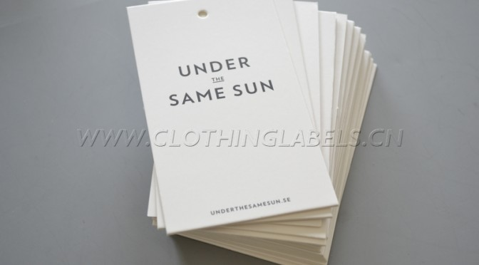 UNDER THE SAME SUN hang tag