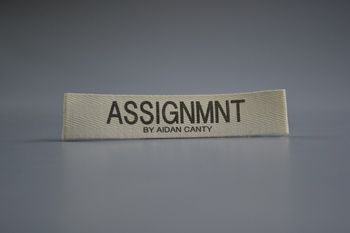 ASSIGNMENT printed label P003168