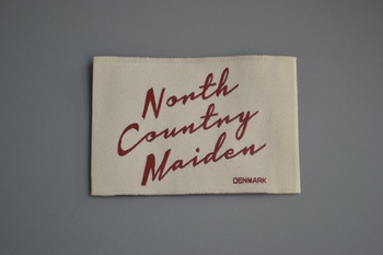 Nonth Country Maiden woven label P003528